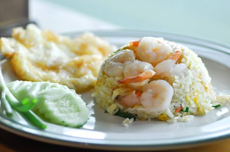 stir-fried rice with shrimp and fried egg and vegetable