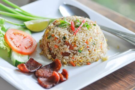 stir-fried rice with deep fried sausage and vegetable 版權商用圖片