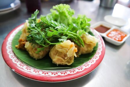 Chinese snacks, rice dough enclosing minced meat and steamed