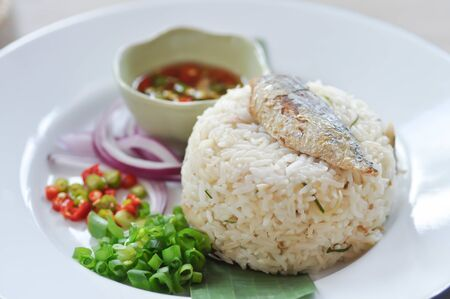 fried rice or stir-fried rice with fish, rice topped with mackerel Stok Fotoğraf - 129748104