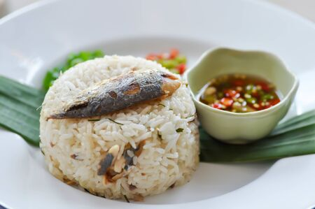 fried rice or stir-fried rice with fish, rice topped with mackerel Stok Fotoğraf - 129748105