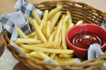 fries, French fries or fried potato with tomato sauce