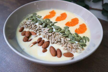 smoothie bowl,mango yogurt with fruit and almond