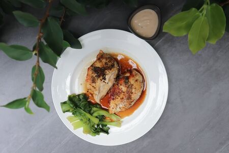 grilled chicken or chicken steak with sauce and vegetable Stock Photo