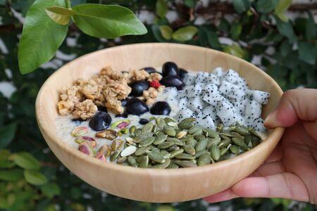smoothie bowl, mango yogurt with fruit and almond