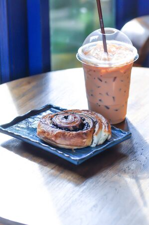 iced coffee, latte or a glass of iced latte and danish