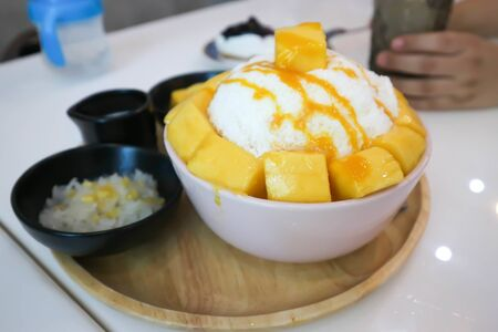 shave ice, shaved ice or snowflake ice with mango topping