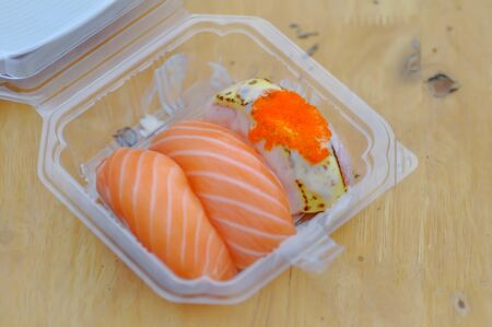 sushi or rice topped with salmon, Japanese food