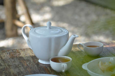 tea cup and tea pot on the table