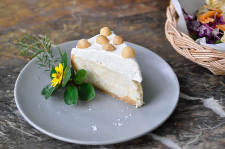 coconut cake with cream and macadamia topping 免版税图像
