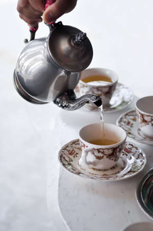 tea or a cup of tea and steel kettle