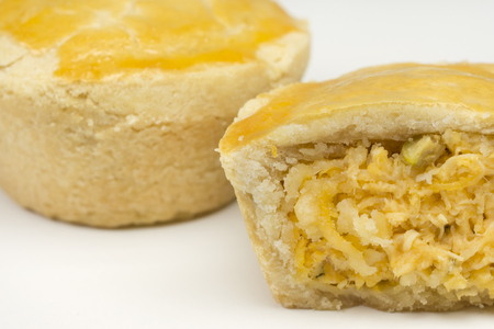 Two traditional Brazilian mini chicken pies