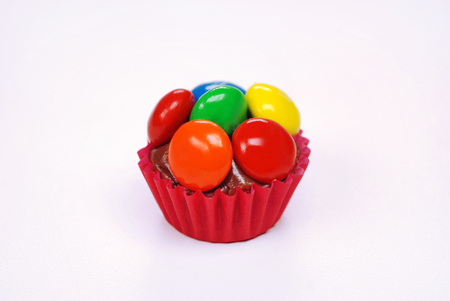 One traditional Brazilian chocolate candy called brigadeiro in m & ms gourmet version Banco de Imagens