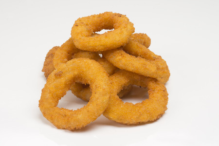 Onion rings in white background Imagens