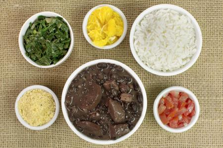 Traditional Brazilian recipe Feijoada in jute background seen from above