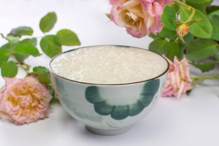 Brazilian dessert made of tapioca pearls called sagu in cream flavor in a bowl with roses in the background Reklamní fotografie