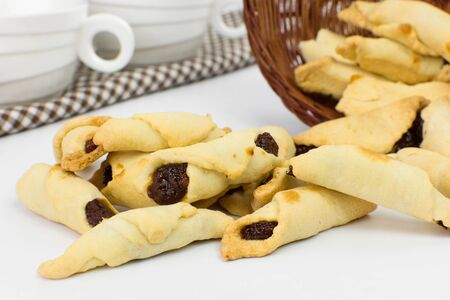 Traditional Brazilian buttered cookies stuffed with guava paste called goiabinha ou beliscão in white breakfest table