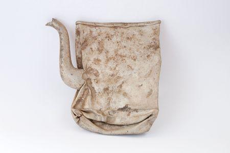 flatly: Old and  broken pot made from aluminium