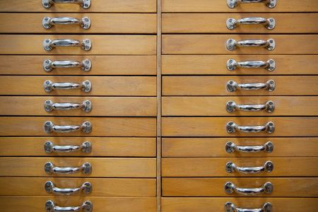 Many beautiful old drawers with metal grips photo