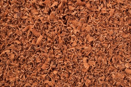 Manually rasped chocolate as a nice background motive photo