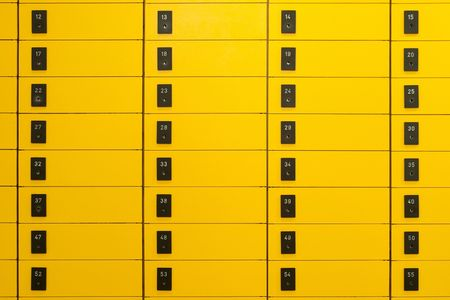 numbering: Yellow post office boxes with numbering on black signs