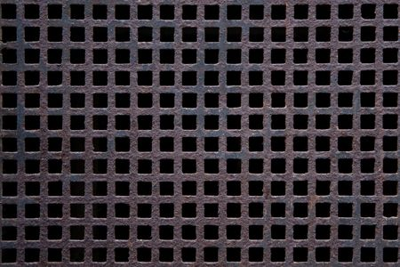 flatly: Rusted grid from metal as a background motive Stock Photo