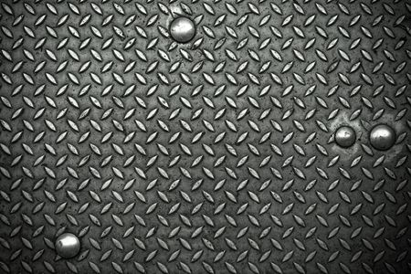steadily: Metal surface No.4 with rivets as a background motive Stock Photo