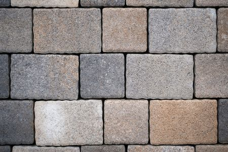 steadily: Background from paving stones, rectangular stones in gray shades of color