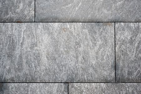 House wall from granite as a background motive Stock Photo