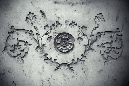 steadily: Ornament with botanical motives on an old sandstone wall