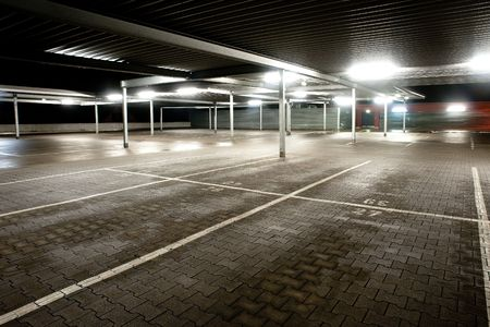 car in garage: Night exposure of an empty parking level of a supermarket