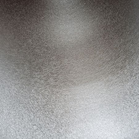 moulder: Structured metal surface as an abstract background motive Stock Photo