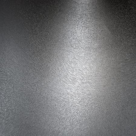 Structured metal surface as an abstract background motive Stock Photo