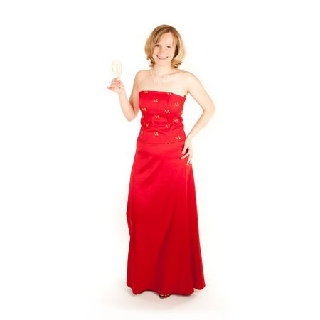 erotical: Pretty young woman in long red dress with champagne glass