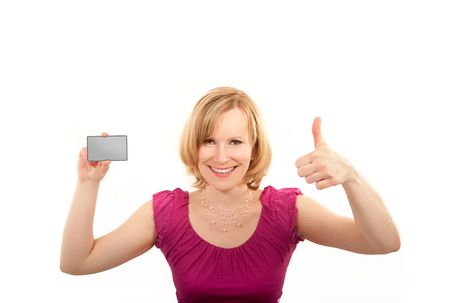 Pretty young woman  thumb up and presenting credit card photo