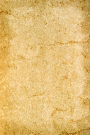Grungy old gone yellow paper as a background motive Stock Photo