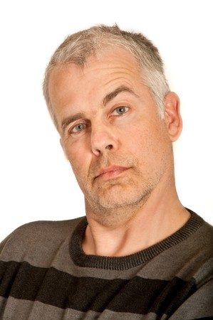 Man looks with pulled up eyebrow directly into the camera Stock Photo