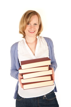 Pretty young woman with a pile of books photo