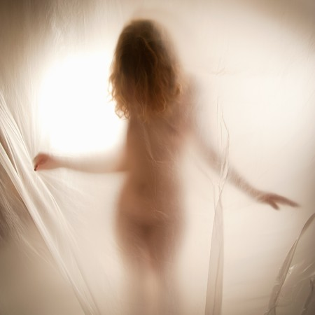 nice breast: Sexy young woman spreading her arms behind transparent curtain