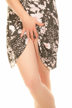 Sexy young woman with slender legs lifting her dress  photo