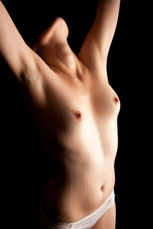 wet breast: Semi-nude wet torso of a beautiful young woman, soap running down her body