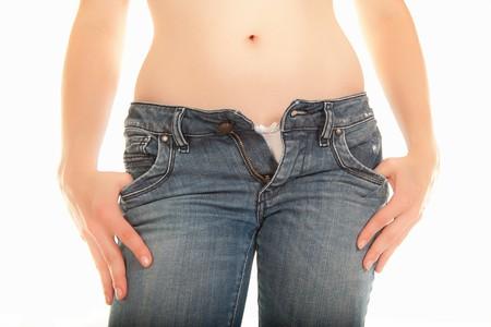 white panties: Sexy junge Frau mit offenen Jeans und wei� H�schen  Lizenzfreie Bilder
