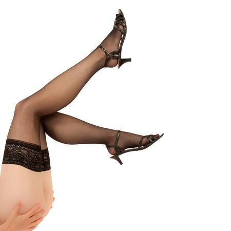 Schlanke Beine einer sexy Frau in schwarzem Nylon-Strümpfe  Lizenzfreie Bilder - 7629976