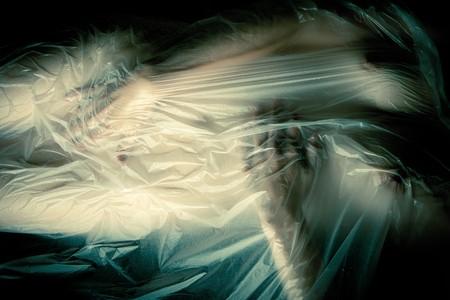Sexy young woman touching herself under wet transparent foil Standard-Bild
