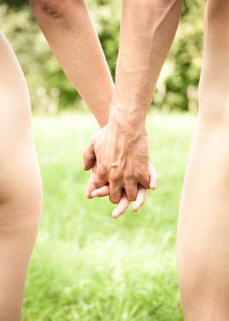 Naked young couple walking hand in hand in nature Stock Photo - 7846113
