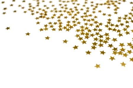 Many golden stars, isolated on white background Stock Photo