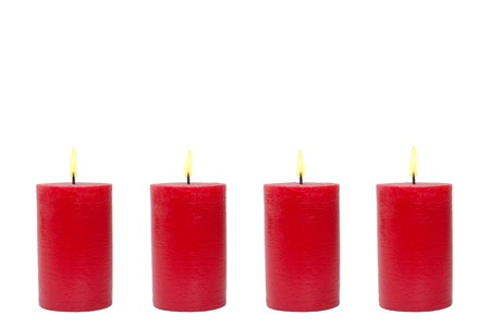 Four burning red candles in front of white background photo