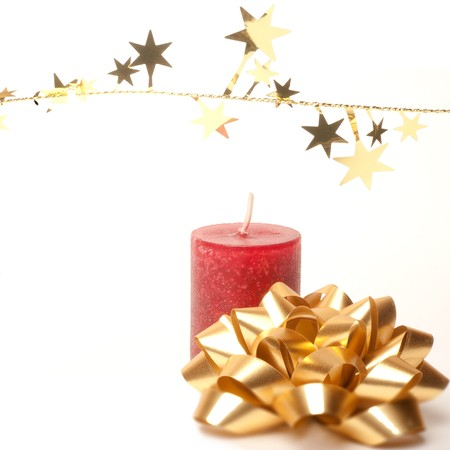 Christmas decoration with red candle, golden stars and loop photo