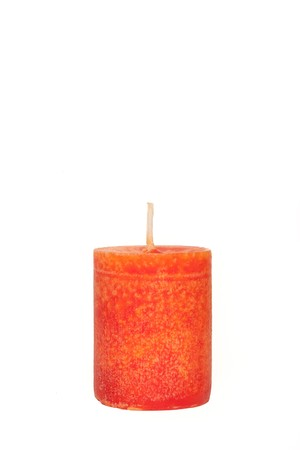 A single burning red candle  isolated in front of white background Standard-Bild