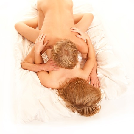 Loving young couple on white bedclothes